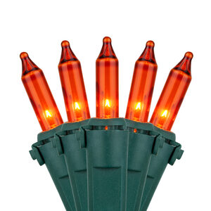 "50 Premium Amber Mini Halloween Lights, 4"" Spacing, Green Wire"